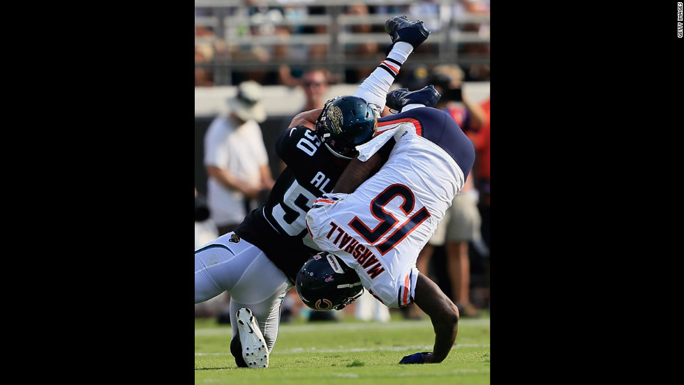 Russell Allen of the Jaguars tackles Brandon Marshall of the Bears on Sunday.