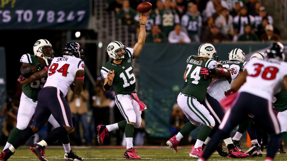 Tim Tebow of the New York Jets takes a snap during Monday
