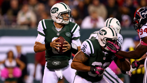 Jets quarterback Mark Sanchez looks to pass in the first half of Monday night