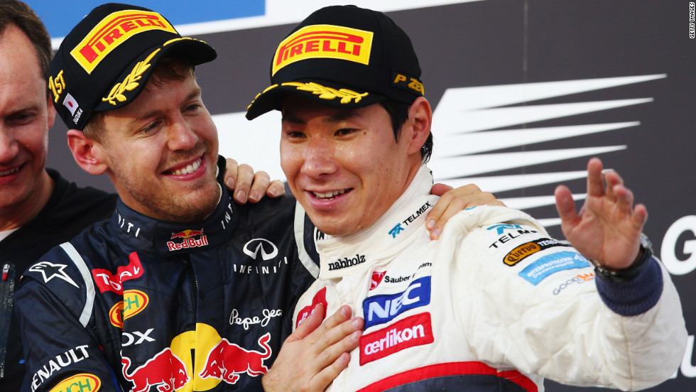 Race winner Sebastian Vettel congratulates third-placed Kobayashi on his maiden podium finish. Kobayashi made his Grand Prix debut in 2009.