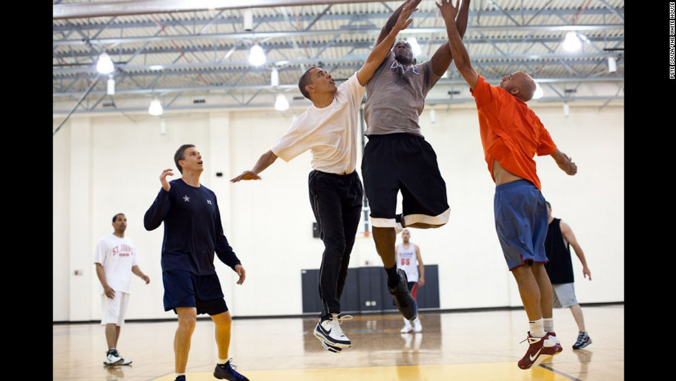 Obama tries to block a layup by his former personal aide, Reggie Love, at Fort McNair in Washington on May 16, 2010.