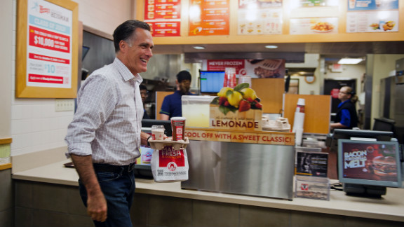 Republican presidential candidate Mitt Romney departs a Wendy