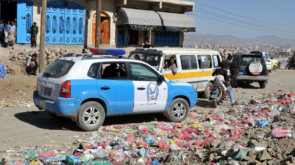 A police car is parked at the scene where unidentified gunmen shot dead a senior Yemeni security official.
