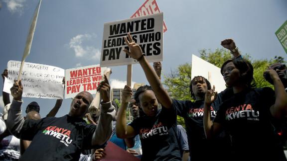 Kenyan demonstrators march in Nairobi after lawmakers voted themselves a 110,000 US dollar sendoff bonus.