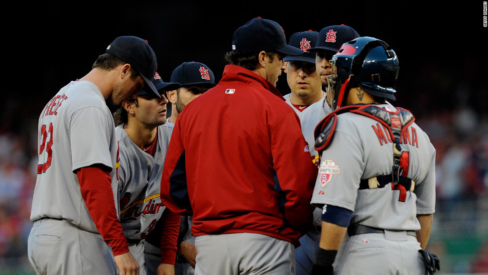 Cardinals Manager Mike Matheny talks with starting pitcher Kyle Lohse and other players on the mound during Thursday's Game 4 of the National League Division Series in Washington.