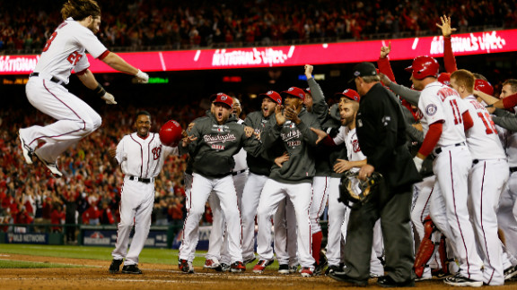 Jayson Werth is met by his Washington Nationals teammates as he jumps on home plate after his game-winning solo home run in the bottom of the ninth inning Thursday against the St. Louis Cardinals in Game 4 of the National League Division Series at Nationals Park.
