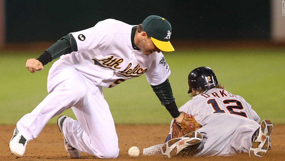 Detroit's Andy Dirks steals second base as Oakland's Stephen Drew is unable to apply the tag in the second inning Thursday night in Oakland.