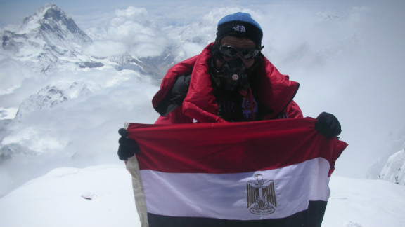 Omar Samra is an Egyptian explorer and the youngest Arab ever to climb Mount Everest. Here he poses with his country's national flag atop the world's highest peak.