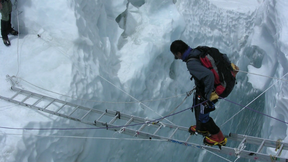 Hair-raising activities like this ladder crossing at the Khumbi ice fall near the base of Mount Everest are a world away from Samra