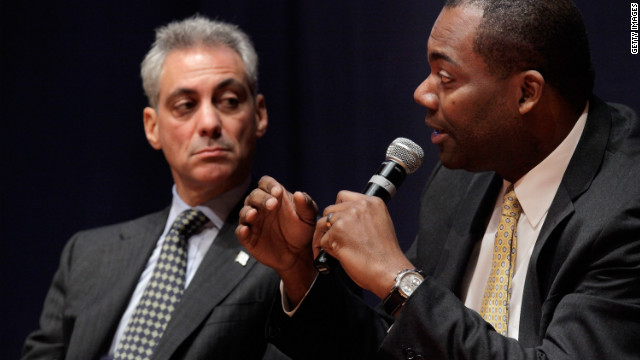 Jean-Claude Brizard, here seen with Chicago Mayor Rahm Emanuel, has lost his job as school CEO, the school system said.
