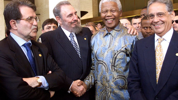 Castro puts his arm around South African President Nelson Mandela in May 1998 with Italian Prime Minister Romano Prodi, left, and Brazilian President Fernando Henrique Cardoso. They were in Geneva, Switzerland, for a conference of the World Trade Organization.