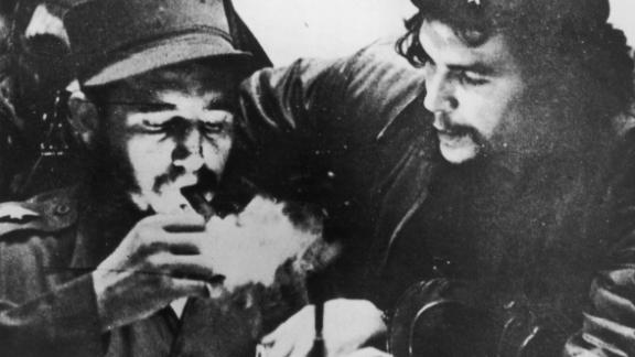 Fidel Castro, seen here lighting a cigar with revolutionary Che Guevara, brought communism to Cuba. He also gave rise to one of the most powerful pressure groups in American politics, the Cuba lobby. This relatively small group of Cuban exiles hated Castro and shaped America's foreign policy with Cuba for nearly 50 years.