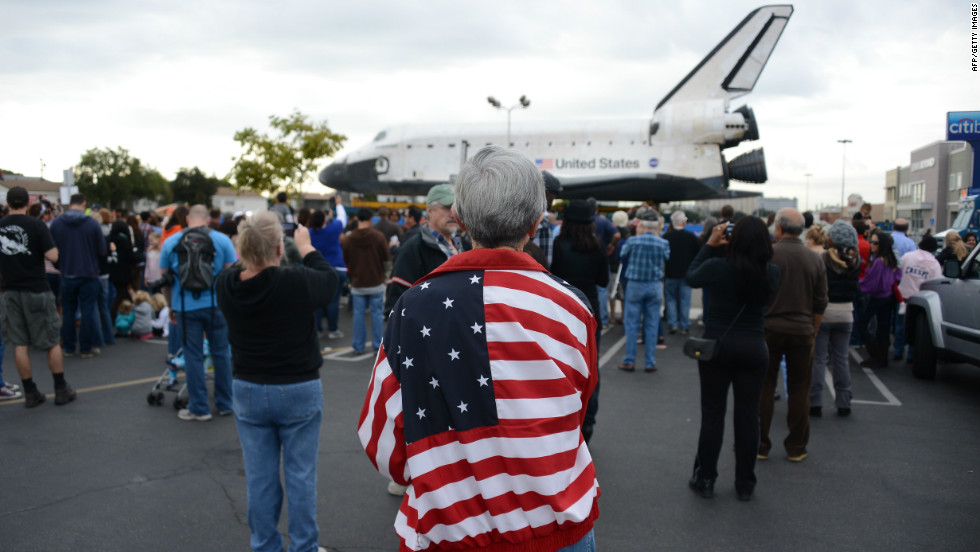 Spectators come to watch the space shuttle Endeavour as it rests at Westchester Square during its final ground journey in Los Angeles on Friday.