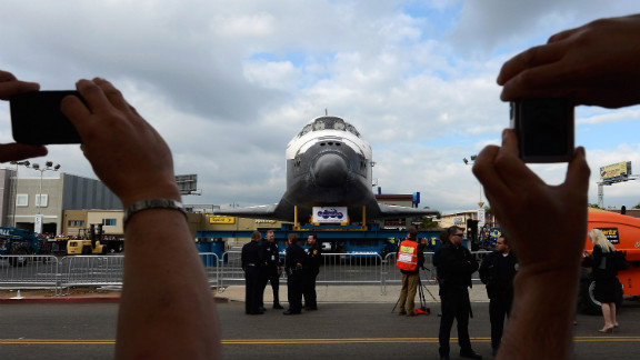 Spectators take pictures of Endeavour during its journey through Los Angeles.