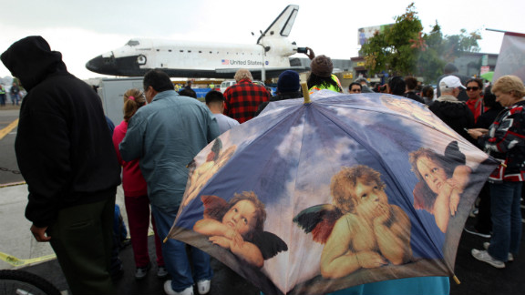 People get a close view of the space shuttle Endeavour in a misty rain during a break in its journey on Friday.