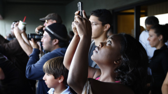 Spectators crowd for a view of Endeavour as it passes through Los Angeles on Friday.