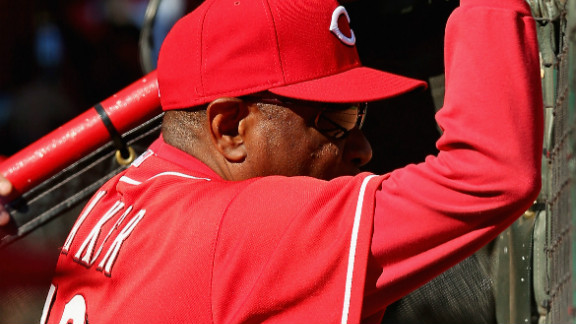 Manager Dusty Baker watches his Cincinnati Reds take on the San Francisco Giants in Game 5 of the National League Division Series on Thursday at Great American Ball Park in Cincinnati. The Giants defeated the Reds 6-4 to win the series.