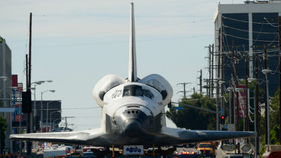 The space shuttle Endeavour is transported to the California Science Center in Exposition Park from Los Angeles International Airport on Friday, October 12, in Los Angeles.