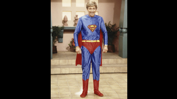 """Collins poses in a Superman costume during the taping of """"Hour Magazine"""" in 1987 in West Hollywood, California."""