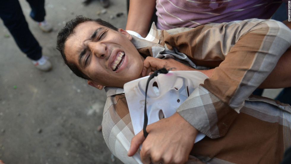 Egyptians evacuate a wounded man during clashes on Friday.
