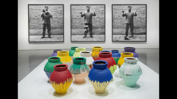 """""""Dropping a Han Dynasty Urn"""" (1995/2009), top, is a photographic triptych that confronts the power of ancient symbols, according to the museum, while """"Colored Vases"""" (2007-2010) seeks to replace those symbols with new works."""