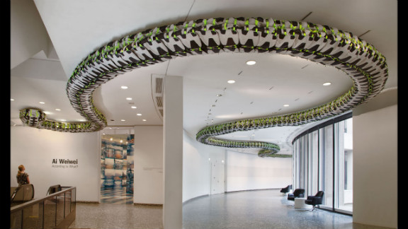 """""""Snake Ceiling"""" (2009) uses hundreds of backpacks to represent children's backpacks left behind after the 2008 Sichuan earthquake."""