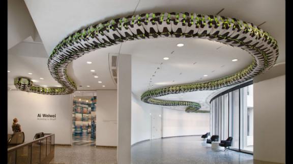 """""""Snake Ceiling"""" (2009) uses hundreds of backpacks to represent children"""