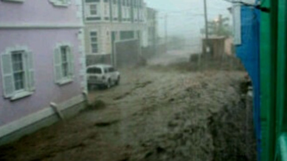 College Street, which  runs through the middle of Basseterre, is filled with floodwaters.