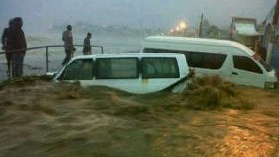 Two taxis were washed down to the shoreline when they tried to cross a flooded area on Bay Road in Basseterre, St. Kitts.