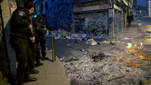 Security personnel take positions during a deployment to pacify shantytowns in Rio de Janeiro on Sunday.