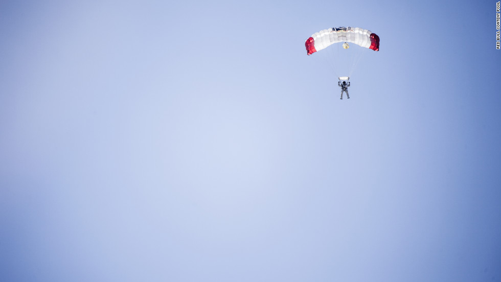 Baumgartner parachutes to Earth after his record-breaking skydive on Sunday.