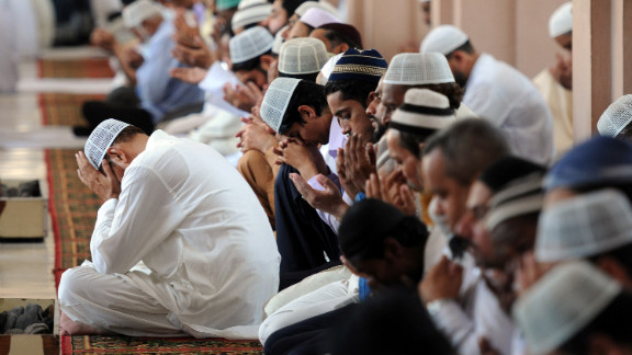 Pakistani Muslims bow their heads and pray for Malala during Friday prayers in Karachi.