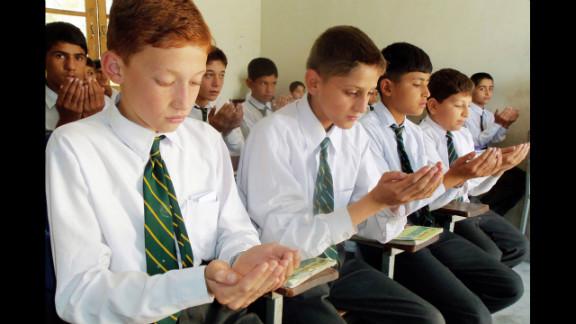 Pakistani students pray for Malala at a school in Mingora on Thursday.