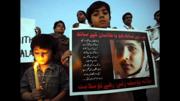 Children of Pakistani journalists and civil society activists light candles in Islamabad.