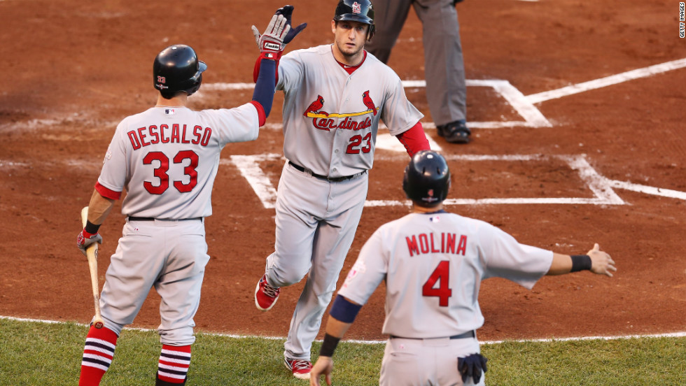 David Freese, center, celebrates with Daniel Descalso and Yadier Molina after hitting a two-run home run in the second inning on Sunday.