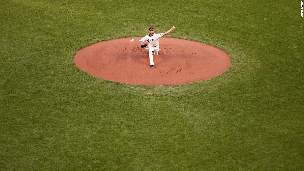 Giants pitcher Madison Bumgarner throws the ball during Sunday's game against the Cardinals.