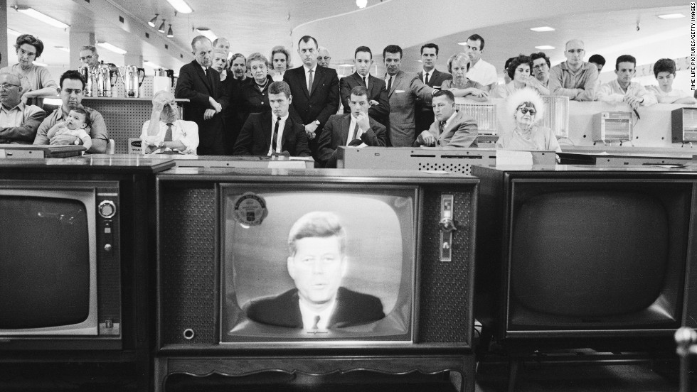 People gather in an electronics store to watch American President John F. Kennedy deliver a nationally televised address on the Cuban missile crisis on October 22, 1962.