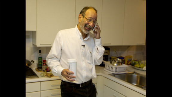 "Alvin Roth receives congratulatory phone calls at his home in Menlo Park, California, on Monday, October 15, after winning the Nobel Memorial Prize in Economics, which he shared with Lloyd Shapley. Roth was ""surprised"" and ""delighted"" when he got the midnight call at his California home telling him he had won."