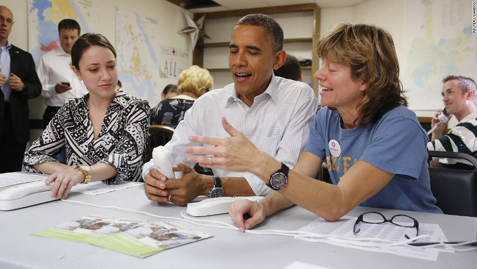 Obama jokes about a telephone with campaign volunteers Alexa Kissinger, left, and Suzanne Stern as he makes calls from a campaign office in Williamsburg, Virginia, on Sunday, October 14.