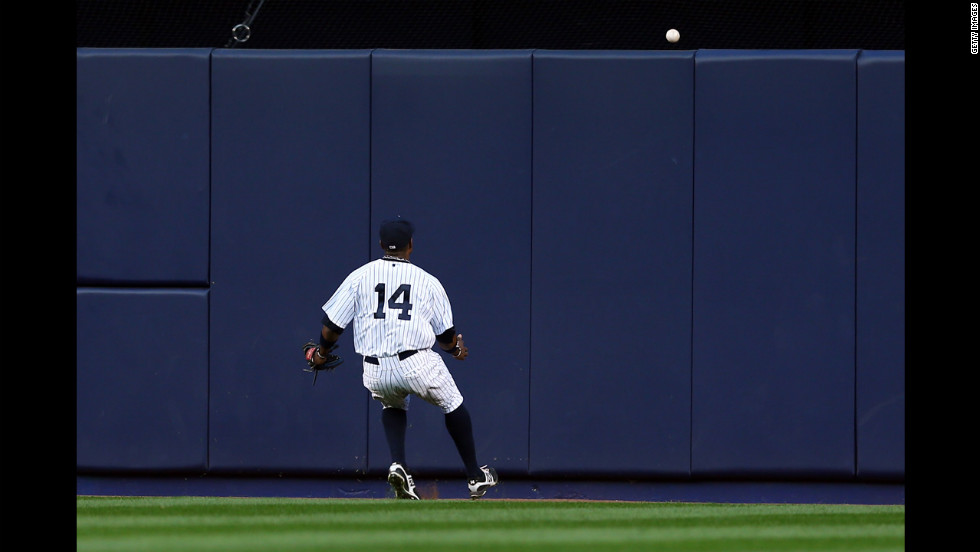 New York's Curtis Granderson can't make a play on a ground rule double hit by Quintin Berry in the seventh inning.