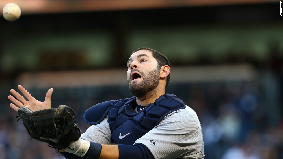 Alex Avila of the Detroit Tigers misses a play on a foul ball hit by Raul Ibanez of the New York Yankees in the fourth inning.