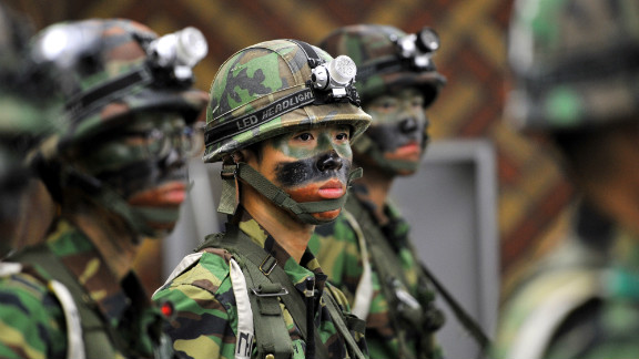 South Korean soldiers stand guard during a joint US-South Korean military exercise in Seoul on August 21, 2012.