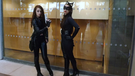 "Here's an unusual pairing, Black Widow from Marvel's ""Avengers"" and Catwoman  from ""The Dark Knight Rises,"" a DC Comics character. At the same time, that's not so unusual a sight for conventions such as New York Comic Con."