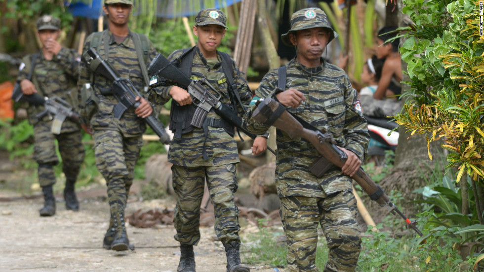 Rebel Leaders Filipino Officials Sign Landmark Peace Deal Cnn