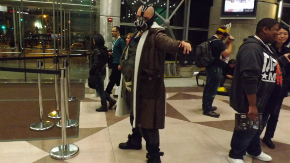 "Don't worry, Bane's not robbing a bank here. But fans dressed as the ""Dark Knight Rises"" character were seen in many of the iReport photos from New York Comic Con."