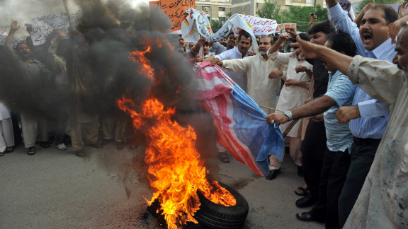Pakistanis burn a U.S. flag during a protest against an anti-Islam movie in Islamabad on September 15. Columnist Masud Alam says relations between the two countries are at an all-time low.