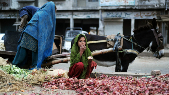 A Pakistani girl collects onions in the garbage of vegetable market in the capital in 2009. While Islamabad's 'civil society' is following the U.S. election, Alam says the race is only of marginal interest to Pakistan's working classes.