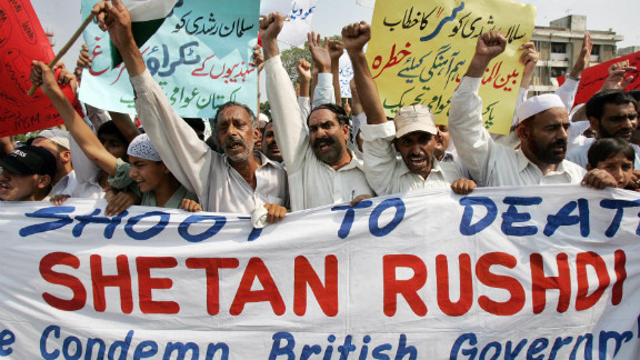 """Activists chant anti-British slogans during a protest against Salman Rushdie's """"Satanic Verses"""" in 2007. Alam says despite the fact Rushdie is British, Pakistanis protested the publishing of his book outside the American Center in Islamabad in 1989."""