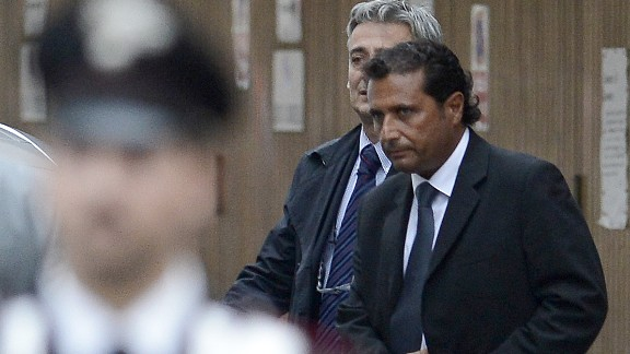 The captain of the Costa Concordia Francesco Schettino (R) leaves after hearings on October 15, 2012.