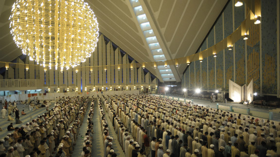 """People pray inside the Faisal Mosque in the capital. Alam says Pakistan remains """"a state living on the edge of being labeled a failure, with a population that largely believes America is indeed the Satan."""""""